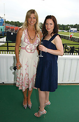 Left to right, the MARCHIONESS OF MILFORD-HAVEN and EVA BIRTHISTLE at the Queen's Cup polo final sponsored by Cartier at Guards Polo Club, Smith's Lawn, Windsor Great Park on 18th June 2006.  The Final was between Dubai and the Broncos polo teams with Dubai winning.<br />