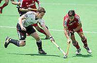 MELBOURNE - Thomas Briels (r) van Belgie met de Duitser  Moriz Polk tijdens de wedstrijd om de vijfde plaats  tussen de mannen van Belgie en Duitsland (5-4 GG) bij de Champions Trophy hockey in Melbourne. ANP KOEN SUYK