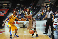 "Ole Miss' Jarvis Summers (32) vs. McNeese State's Dontae Cannon (5) at the C.M. ""Tad"" Smith Coliseum in Oxford, Miss. on Tuesday, November 20, 2012. .."