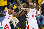 Golden State Warriors forward Draymond Green (23) is double teamed by Houston Rockets guard James Harden (13) adn Houston Rockets forward PJ Tucker (4) during Game 4 of the Western Conference Finals at Oracle Arena in Oakland, Calif., on May 22, 2018. (Stan Olszewski/Special to S.F. Examiner)