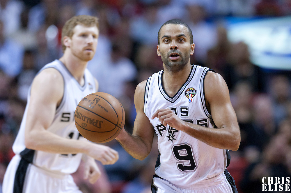 14 March 2011: San Antonio Spurs point guard Tony Parker (9) brings the ball upcourt during the Miami Heat 110-80 victory over the San Antonio Spurs at the AmericanAirlines Arena, Miami, Florida, USA.