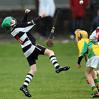 Jack Murphy Clarecastle U13's looses his hurley as he clears against Tobias O'Meara  Feakle/Killanena. Photograph by Flann Howard
