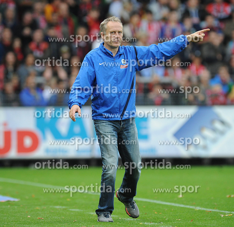 27.10.2013, Mage Solar Stadion, Freiburg, GER, 1. FBL, SC Freiburg vs Hamburger SV, 10. Runde, im Bild Christian Streich (Chef-Trainer SC Freiburg) // during the German Bundesliga 10th round match between SC Freiburg and Hamburger SV at the Mage Solar Stadion in Freiburg, Germany on 2013/10/27. EXPA Pictures &copy; 2013, PhotoCredit: EXPA/ Eibner-Pressefoto/ Laegler<br /> <br /> *****ATTENTION - OUT of GER*****