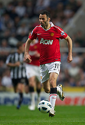 NEWCASTLE, ENGLAND - Tuesday, April 19, 2011: Manchester United's Ryan Giggs in action against Newcastle United during the Premiership match at St James' Park. (Photo by David Rawcliffe/Propaganda)