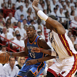 Jun 17, 2012; Miam, FL, USA; Oklahoma City Thunder small forward Kevin Durant (35) drives against Miami Heat power forward Chris Bosh (1) during the first quarter in game three in the 2012 NBA Finals at the American Airlines Arena. Mandatory Credit: Derick E. Hingle-US PRESSWIRE