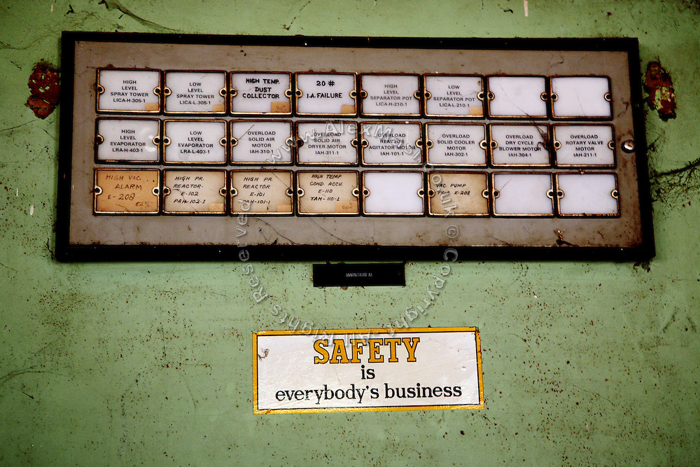 A sticker (Safety is Everybody'ƒÙs Business) is found inside the abandoned Union Carbide (now DOW Chemical) control room in Bhopal, Madhya Pradesh, India, site of the infamous 1984 gas disaster.