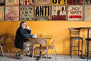 Canada, Ontario. Windsor. Man drinking coffee at MILK Coffee Bar. 2015.