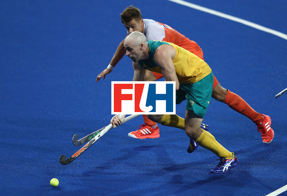 RIO DE JANEIRO, BRAZIL - AUGUST 14:  Glenn Turner of Australia moves away from Sander de Wijn during the Men's hockey quarter final match between the Netherlands and Australia on Day 9 of the Rio 2016 Olympic Games at the Olympic Hockey Centre on August 14, 2016 in Rio de Janeiro, Brazil.  (Photo by David Rogers/Getty Images)