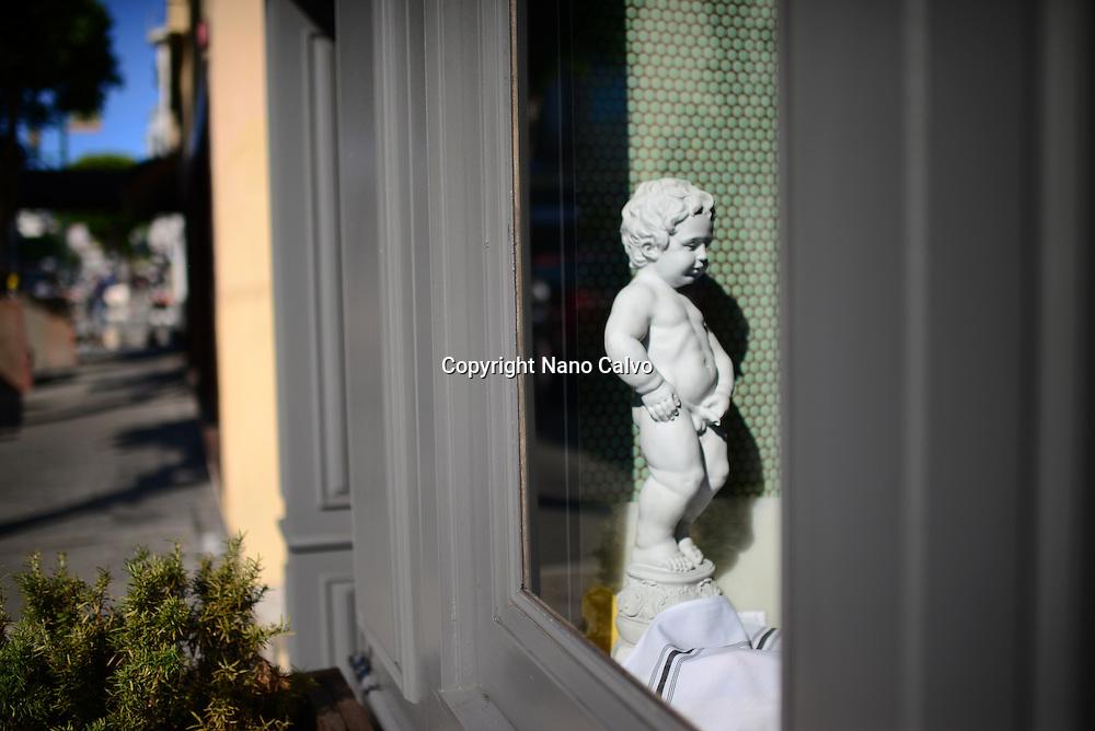 Replica of popular Manneken Pis sculpture in restaurant. San Francisco, California.