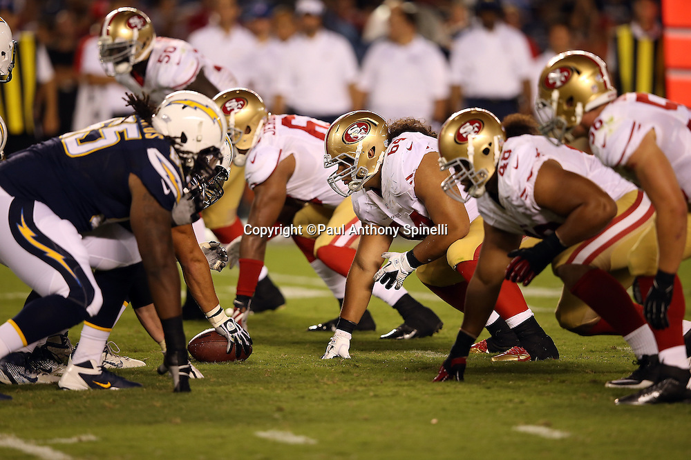 The San Francisco 49ers defense gets set at the line of scrimmage during the NFL week 4 preseason football game against the San Diego Chargers on Thursday, Aug. 29, 2013 in San Diego. The 49ers won the game 41-6. ©Paul Anthony Spinelli
