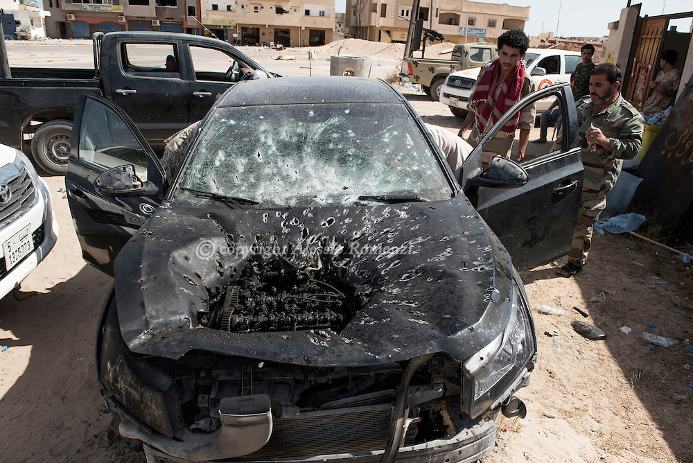 Libya: Car of the reporters damaged by mortar fired from ISIS militants. The driver was slightly injured by shrapnels on a foot as he was inside the vehicle in Sirte. Alessio Romenzi