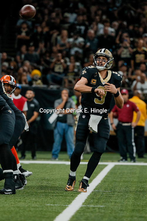 Sep 16, 2018; New Orleans, LA, USA; New Orleans Saints quarterback Drew Brees (9) throws a touchdown pass to wide receiver Michael Thomas (not pictured) during the fourth quarter of a game at the Mercedes-Benz Superdome. The Saints defeated the Browns 21-18. Mandatory Credit: Derick E. Hingle-USA TODAY Sports