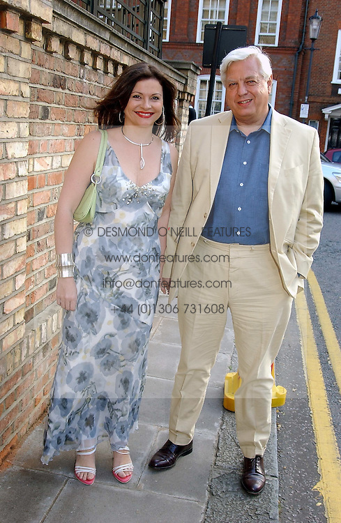 MR & MRS JOHN SIMPSON he is the BBC News reporter at Sir David & Lady Carina Frost's annual summer party held in Carlyle Square, London on 6th July 2004.