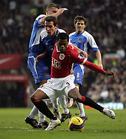 Photo: Paul Thomas.<br />Manchester United v Wigan Athletic. The Barclays Premiership. 26/12/2006.<br /><br />Patrice Evra (Red) of Man Utd looks to be fouled by Leighton Baines.