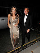 10.NOVEMBER.2011. LONDON<br /> <br /> AN ENGAGEMENT RINGLESS LIZ HURLEY AND HER NEW FIANCEE SHANE WARNE RETURN HOME AFTER A NIGHT OUT IN LONDON.<br /> <br /> BYLINE: EDBIMAGEARCHIVE.COM<br /> <br /> *THIS IMAGE IS STRICTLY FOR UK NEWSPAPERS AND MAGAZINES ONLY*<br /> *FOR WORLD WIDE SALES AND WEB USE PLEASE CONTACT EDBIMAGEARCHIVE - 0208 954 5968*