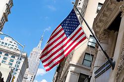THEMENBILD - Das Empire State Building ist ein Wolkenkratzer im New Yorker Stadtteil Manhattan. Mit einer Höhe von 443 Metern war es lange Zeit das höchste Gebäude der Welt. Bis heute gilt das Empire State Building als Wahrzeichen von New York, im Bild eine USA Flagge mit dem Empire State Building, Aufgenommen am 14. August 2016 // The Empire State Building is a skyscraper in Manhattan. It stands 443 Meter high and was the tallest building of the world for a long time. It is deemed to be the town's landmark, This picture shows a US flag with the Empire State Building, New York City, United States on 2016/08/14. EXPA Pictures © 2016, PhotoCredit: EXPA/ Sebastian Pucher