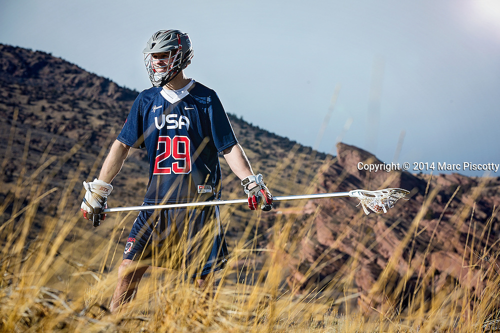 SHOT 2/22/14 3:58:00 PM - Denver Outlaws and Team USA defenseman Lee Zink poses for a portrait with Red Rocks and the foothills just outside of Denver, Co. in the background. Zink was named the 2012 Major League Lacrosse Defensive Player of the Year. When Zink grew up in Darien, Conn., and started his lacrosse career in sixth grade, he knew defense would be his calling card from the beginning. Zink will be playing in Denver this summer in the 2014 FIL World Lacrosse Championships.<br /> (Photo by Marc Piscotty / &copy; 2014)