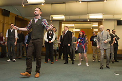 © Licensed to London News Pictures. 23/02/2015. London, England. Pictured: Robin Windsor at the front with MPs Chris Heaton-Harris and Sir Gerald Kaufman at the back. MPs attend a dance class with members of Dance UK and Lindy Hop dancers. Dance UK launches the 2015 Dance Manifesto with a beginners' social dance class hosted by the All Party Parliamentary Dance Group for all MPs at Portcullis House and led by teacher Jenny Thomas, charleston choreographer for the BBC's Strictly Come Dancing with Strictly professional dancer Robin Windsor. Photo credit: Bettina Strenske/LNP