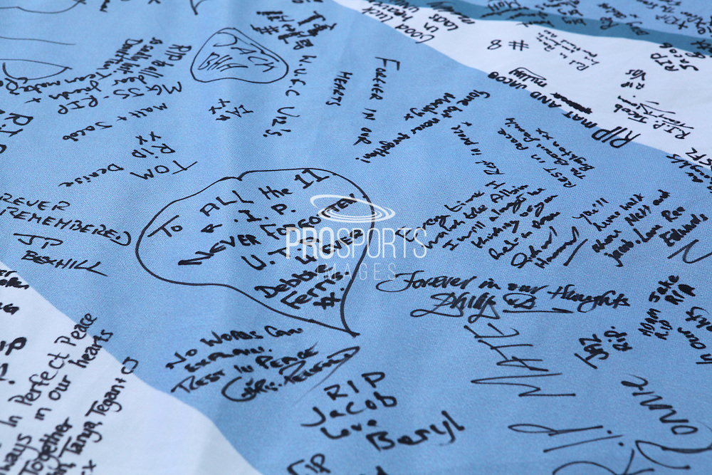 Signatures from fans on a giant shirt for Jacob Schilt as part of the tribute to Matt Grimstone and Jacob Schilt who were killed in the Shoreham air disaster during the Sky Bet Championship match between Brighton and Hove Albion and Hull City at the American Express Community Stadium, Brighton and Hove, England on 12 September 2015. Photo by Bennett Dean.