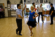 Dance instructor Jesse Desoto trains some of his students at the Fred Astaire Dance Studio in Chicago, Illinois. (Jesse Desoto is one of the people interviewed for the book What I Eat: Around the World in 80 Diets.)