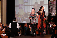 Wearing fashions from Joli, models Dee Crusoe (left) and Kim Blaine on the runway during A'Wear Affair, the Noble Circle fundraising fashion show, at Sinclair College's David H. Ponitz Center, Saturday, February 23, 2013.  Crusoe is 'two years thriving beyond stage 4 lung cancer' and her daughter has been 'thriving beyond breast cancer since 2005.'