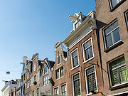 View of Amsterdam's homes, facades, windows. hoists, etc.