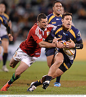 18 June 2013; Matt Toomua, Brumbies, is tackled by Rob Kearney, British & Irish Lions. British & Irish Lions Tour 2013, Brumbies v British & Irish Lions. Canberra Stadium, Bruce, Canberra, Australia. Picture credit: Stephen McCarthy / SPORTSFILE