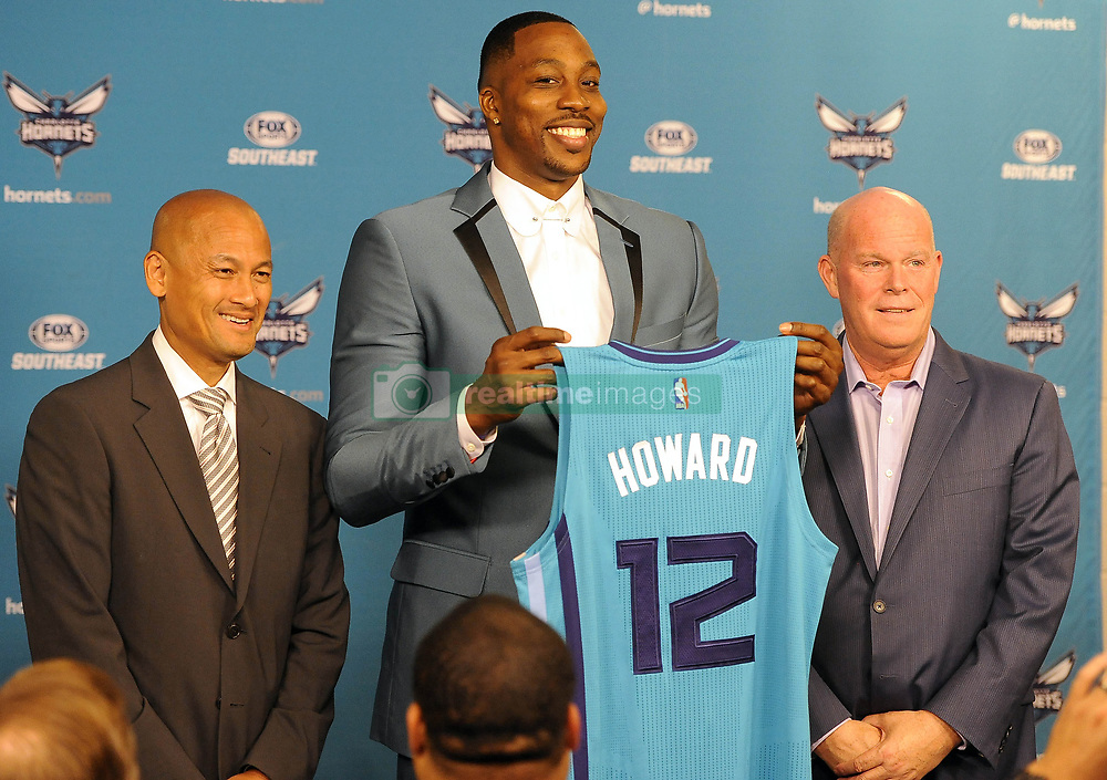 June 26, 2017 - Charlotte, NC, USA - The Charlotte Hornets' new center Dwight Howard holds up his jersey with General Manager Rich Cho, left, and head coach Steve Clifford during a news conference on Monday, June 26, 2017 at the Spectrum Center in Charlotte, N.C. (Credit Image: © David T. Foster Iii/TNS via ZUMA Wire)