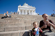 Senate Square; the lutheran Cathedral. Mother and kid having an ice cream.