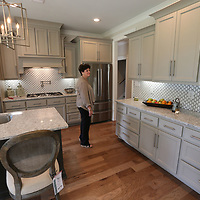 Martha Waycaster admires the kitchen of the St. Jude Dream Home which she and her husband, Benny, won recently.