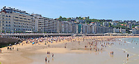 Bathers, sun worshippers, Bahia de la Concha, Sea-shell Bay, San Sebastian, Donostia, Spain, May, 2015, 201505101019<br />