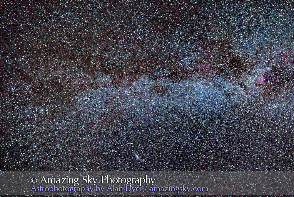 The Milky Way from Perseus, at left, to Cygnus, at right, with Cassiopeia (the &ldquo;W&rdquo;) and Cepheus at centre. Dotted along the Milky Way are various red H-alpha regions of glowing hydrogen. The Andromeda Galaxy, M31, is at botton. The Double Cluster star cluster is left of centre. Deneb is the bright star at far right, while Mirfak, the brightest star in Perseus, is at far left. The Funnel Nebula, aka LeGentil 3, is the darkest dark nebula left of Deneb. <br /> <br /> This is a stack of 4 x 1-minute exposures at f/2.8 with the Nikkor 14-24mm lens wide open, and at 24mm, and with the Nikon D810a red-sensitive DSLR, at ISO 1600. Image shot as a test of the gear. It works very well! Shot from home, with the camera on the iOptron Sky-Tracker. Some haze added patches of discolouration and gradients, equalized out here as best I could.