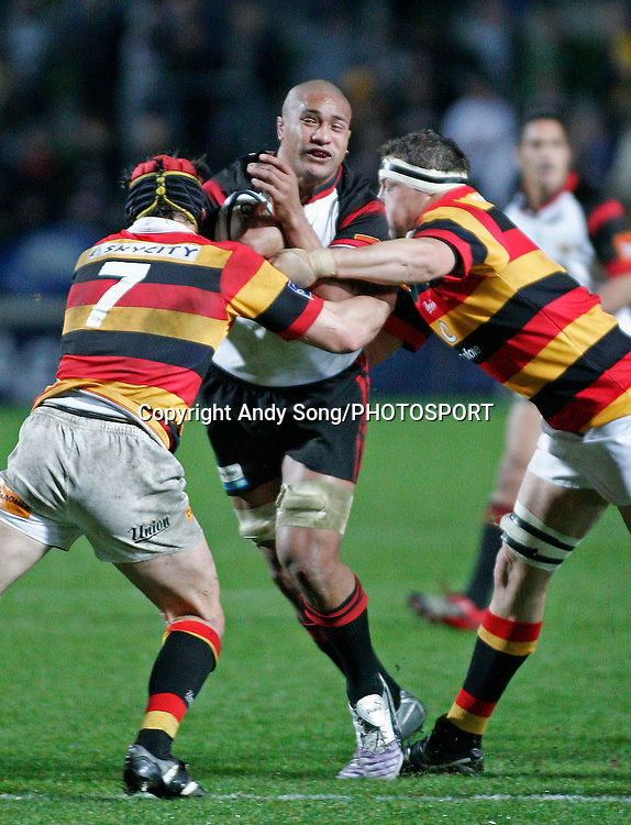 Canterbury #8 Mose Tuiali'i (C) gets tackled during the Air New Zealand Cup week 3 rugby union match between Waikato and Canterbury at Waikato Stadium in Hamilton, New Zealand on Friday 11 August 2006. Photo: Andy Song/PHOTOSPORT