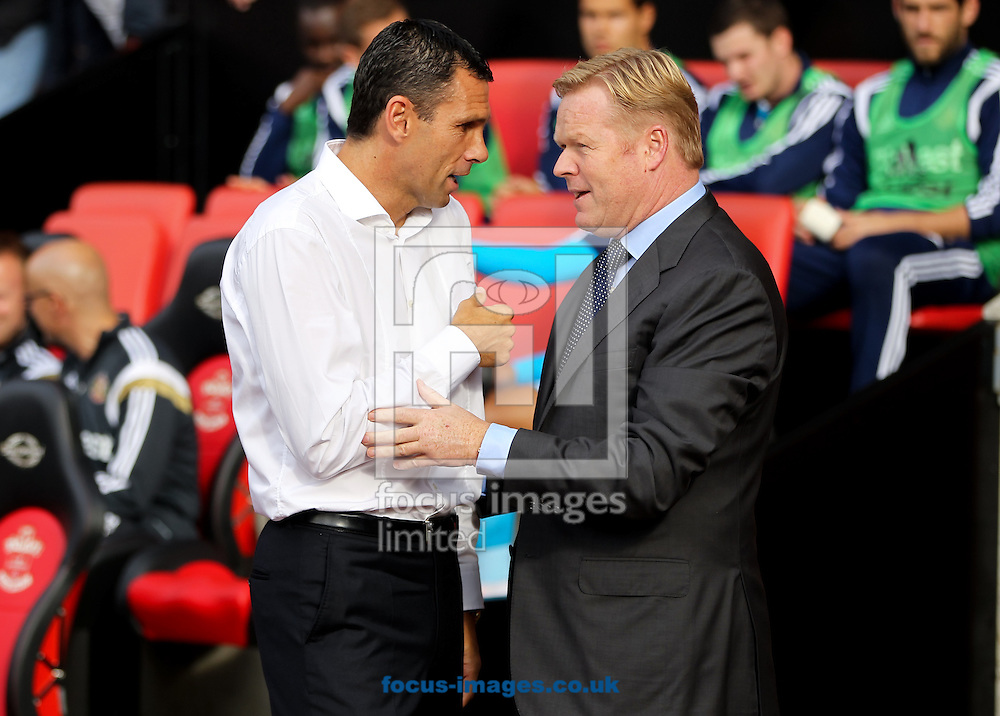 Sunderland manager Gus Poyet (left) and Southampton manager Ronald Koeman (right) greet each other before the Barclays Premier League match at the St Mary's Stadium, Southampton<br /> Picture by Tom Smith/Focus Images Ltd 07545141164<br /> 18/10/2014