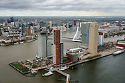 Nederland, Zuid-Holland, Rotterdam, 23-10-2013; Kop van Zuid met Wilhelminakade, Rijhavenbrug en Rijnhaven. Nieuwe Maas met binnenstad Rotterdam met skyline in de achtergrond. Op de Wilhelminakade (vlnr) Hotel New York, World port center, Montevideo, Las Palmas (met NFM, Nederlands fotomuseum), De Rotterdam, New Orleans en het Nieuwe Luxor Theater.<br /> Kop van Zuid - Head of South (Rotterdam), former harbour area, newly developed. High rise buildings, renowned architecture.<br /> luchtfoto (toeslag op standard tarieven);<br /> aerial photo (additional fee required);<br /> copyright foto/photo Siebe Swart
