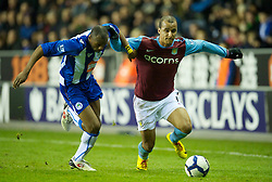 WIGAN, ENGLAND - Tuesday, March 16, 2010: Aston Villa's Gabriel Agbonlahor and Wigan Athletic's Emmerson Boyce during the Premiership match at the DW Stadium. (Photo by David Rawcliffe/Propaganda)