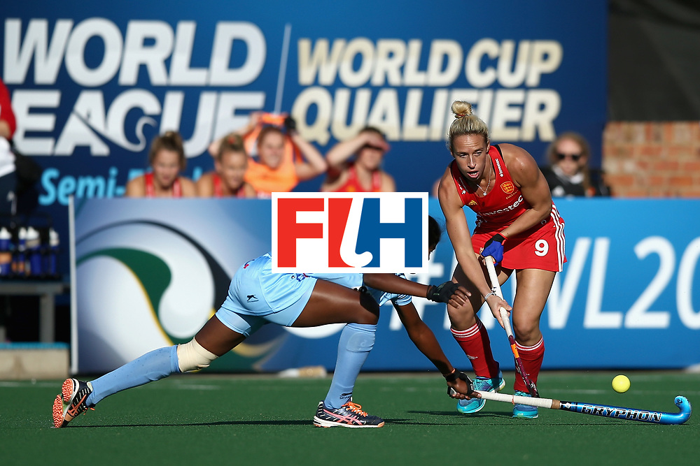 JOHANNESBURG, SOUTH AFRICA - JULY 18: Susannah Townsend of England and Namita Toppo of India battle for possession during the Quarter Final match between England and India during the FIH Hockey World League - Women's Semi Finals on July 18, 2017 in Johannesburg, South Africa.  (Photo by Jan Kruger/Getty Images for FIH)