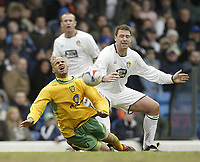 Photo: Aidan Ellis.<br /> Leeds United v Norwich City. Coca Cola Championship. 11/03/2006.<br /> Leeds Paul Butler brings down Norwich's Leon McKenzie