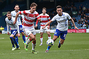 Doncaster Rovers Defender, Mitchell Lund on the ball during the Sky Bet League 1 match between Bury and Doncaster Rovers at the JD Stadium, Bury, England on 9 April 2016. Photo by Mark Pollitt.