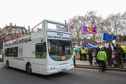 London, UK. 29th January, 2019. A bus commissioned by Leave Means Leave passes rival pro- and anti-Brexit protests outside Parliament on the day of votes in the House of Commons on amendments to the Prime Minister's final Brexit withdrawal agreement which could determine the content of the next stage of negotiations with the European Union.