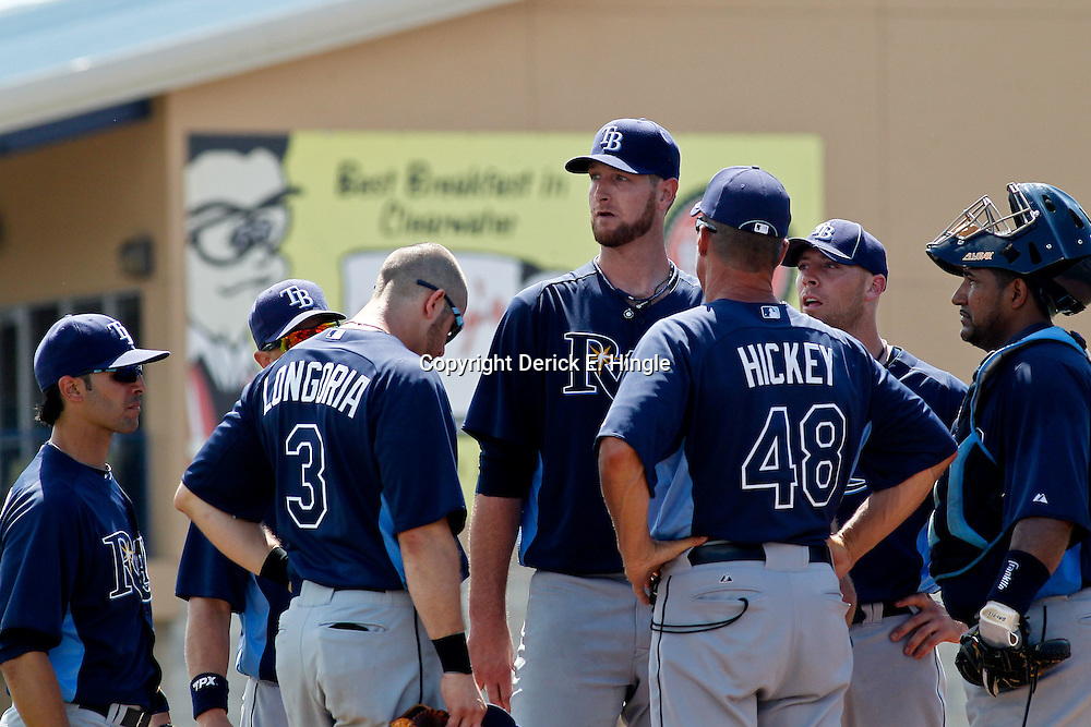 March 16, 2012; Dunedin, FL, USA; Tampa Bay Rays pitching coach Jim Hickey (48) talks with Tampa Bay Rays starting pitcher Jeff Niemann (34) and other players on the mound during the bottom of the fourth inning of a spring training game against the Toronto Blue Jays at Florida Auto Exchange Stadium. Mandatory Credit: Derick E. Hingle-US PRESSWIRE