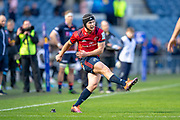 Tyler Bleyendaal (#22) of Munster Rugby kicks a penalty during the Heineken Champions Cup quarter-final match between Edinburgh Rugby and Munster Rugby at BT Murrayfield Stadium, Edinburgh, Scotland on 30 March 2019.