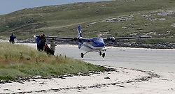 Barra Airport is a short-runway airport situated in the wide shallow bay of Traigh Mhòr at the north tip of the island of Barra in the Outer Hebrides, Scotland. Barra is now the only beach airport anywhere in the world to be used for scheduled airline services. Loganair Twin Otter taking off. (c) Stephen Lawson | Edinburgh Elite media