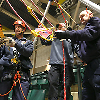 Adam Robison | BUY AT PHOTOS.DJOURNAL.COM<br /> Richie Bryant, shift captain with the New Albany Fire Department, Evan Branham, a Lieutenant with the Amory Fire Department and Buster Hollowell, a captain with the Oxford Fire Department, work together to rig up the high line traverse for Mississippi Task Force 1 training Thursday at the Bancouprsouth Arena.