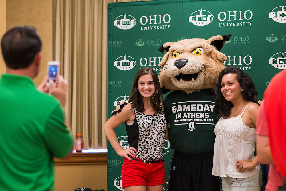 Rufus poses for photos with members of the class of 2019 at the start of Bobcat Student Orientation on Friday, June 5, 2015.  Photo by Ohio University  /  Rob Hardin