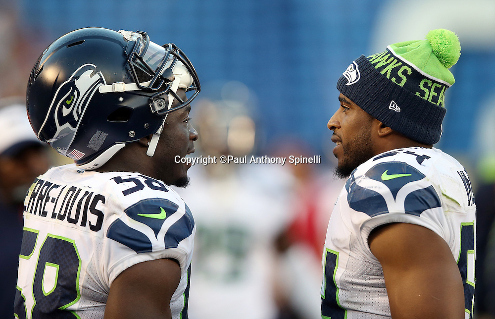 Seattle Seahawks middle linebacker Bobby Wagner (54) talks to Seattle Seahawks linebacker Kevin Pierre-Louis (58) on the sideline during the 2015 NFL preseason football game against the San Diego Chargers on Saturday, Aug. 29, 2015 in San Diego. The Seahawks won the game 16-15. (©Paul Anthony Spinelli)