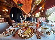India, Madhya Pradesh. Khajuraho station. Maharajas' Express luxury train. Rang Mahal (Color Palace) dining car.