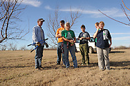 Tim Blackburn owner of Peach Tree Farms gives a group of 4-H members from Pontotoc County some tips on pruning peach trees and general care for better health and yield.