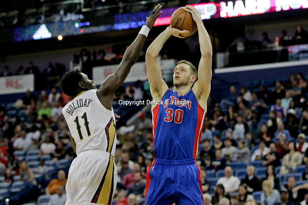 Mar 1, 2017; New Orleans, LA, USA; Detroit Pistons forward Jon Leuer (30) shoots over New Orleans Pelicans guard Jrue Holiday (11) during the first quarter of a game at the Smoothie King Center. Mandatory Credit: Derick E. Hingle-USA TODAY Sports