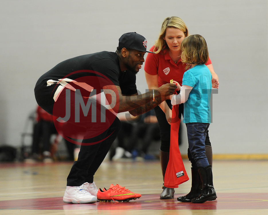 Bristol City's Jay Emmanuel Thomas presents a prize to a bristol flyers fan - Photo mandatory by-line: Dougie Allward/JMP - Mobile: 07966 386802 - 13/02/2015 - SPORT - Basketball - Bristol - SGS Wise Campus - Bristol Flyers v Surrey United - British Basketball League